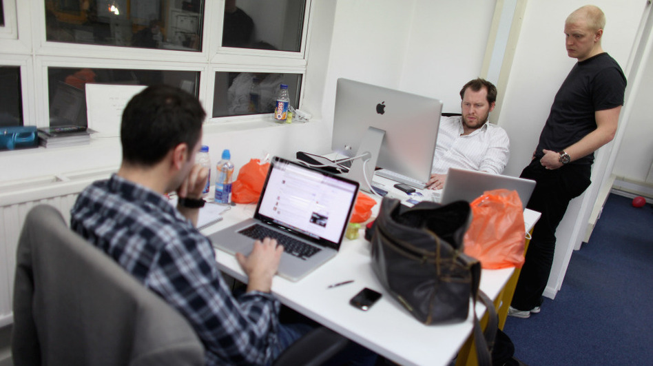 Small startup companies have an advantage, says author Eric Ries: they can test innovative ideas quickly. Here, workers in London talk at TechHub, an office space for technology entrepreneurs. (Getty Images)