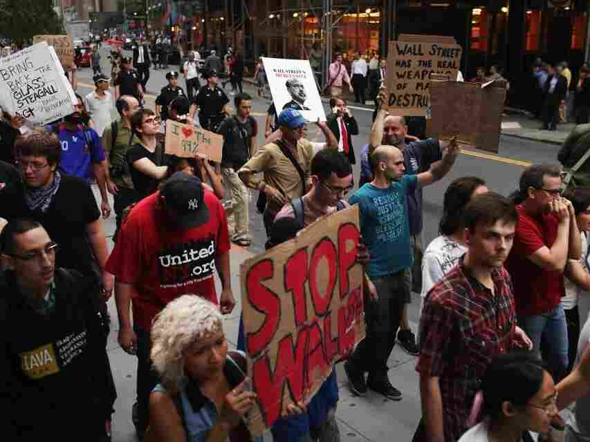 Demonstrators opposed to corporate profits on Wall Street march in the Financial District on September 26, 2011 New York City.