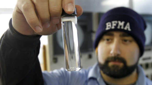 Water plant operator Torrey Jones checks the clarity of a sample of treated water at the Beaver Falls Municipal Authority water treatment plant in Beaver Falls, Pa. (AP)