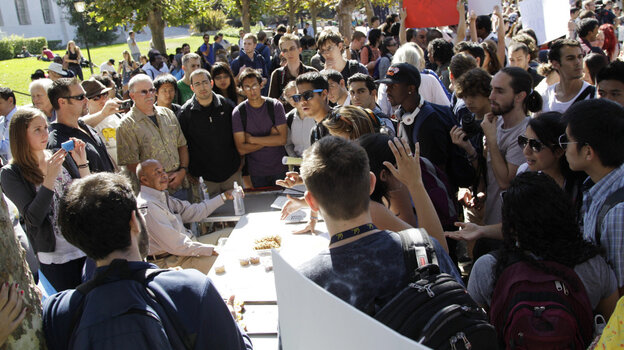 At the bake sale on Tuesday. Protesters to the right. Young Republicans and their supporters to the left.