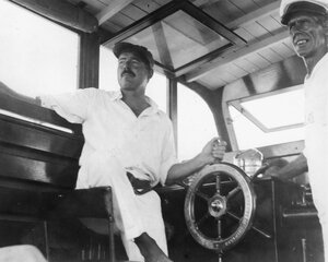 Ernest Hemingway (left) and his guide Carlos Gutierrez navigate Hemingway's boat, Pilar, in 1934.