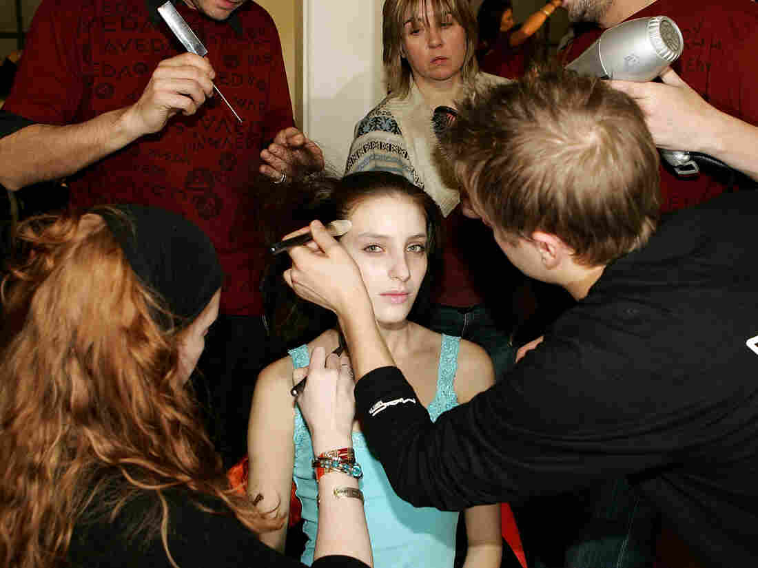 A model being prepared backstage  during London Fashion Week. Many people imagine modeling to be an exciting and  enviable career, but in hour two, we'll reveal how it is often far less glamorous than it seems.