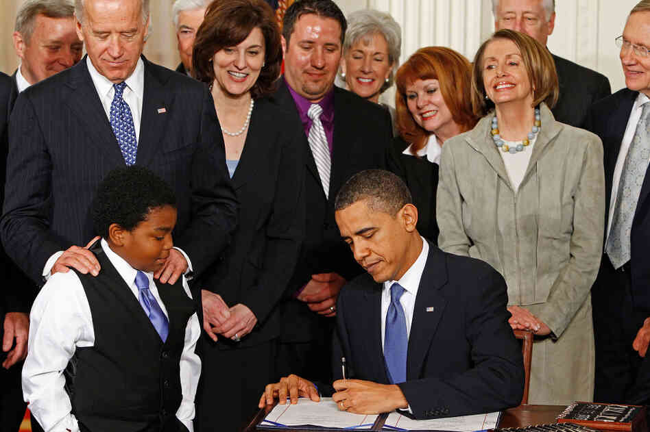 President Obama signing the Affordable Care Act on March 23