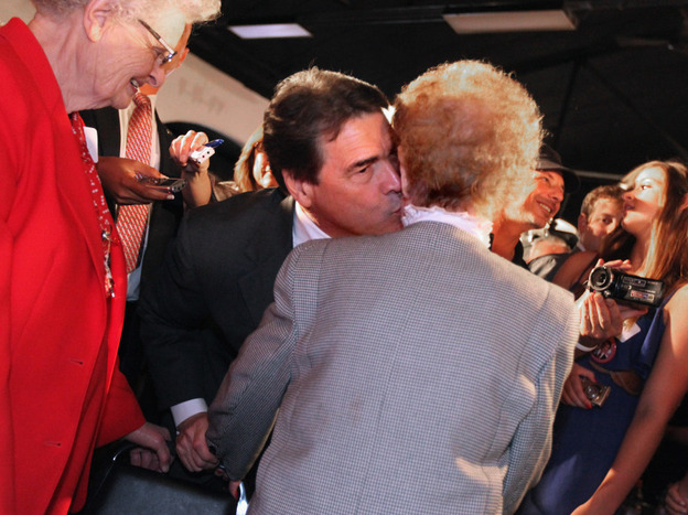 Texas Gov. Rick Perry gives a kiss to 100-year-old Mary Canfield during the Blackhawk County Republican annual Lincoln Day Dinner last month in Waterloo, Iowa. Perry has sought to reassure voters that he won't scrap Social Security.