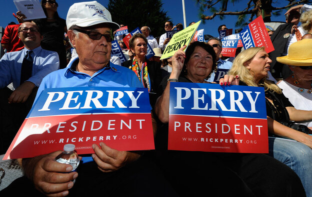 """Supporters of Republican presidential candidate Rick Perry attend a rally earlier this month in Newport Beach, Calif. Though some Republican voters have doubts about Perry, recent polls show it's not because of his stance on Social Security, which he's called a """"Ponzi scheme."""""""
