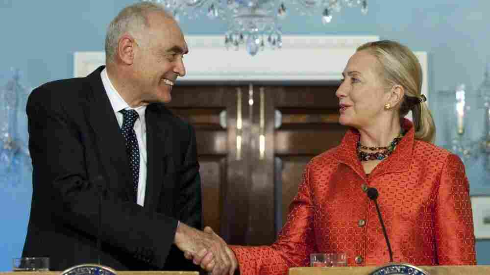 U.S. Secretary of State Hillary Clinton shakes hands with Egypt's Foreign Minister Mohammed Kamel Amr during a joint press conference in Washington on Wednesday. Amr sought to assure the U.S. that Egypt is moving toward democracy.
