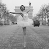 """In France,  feminists are trying to do away with the word """"mademoiselle,"""" which they  see as separating women into two categories — married and unmarried — in  a manner men aren't subjected to. In this photo from 1955, ballerina Christianne Gaulthier, a dancer at the Moulin Rouge, dances through the deserted streets of Paris at the  crack of dawn. But was she a mademoiselle or madame?"""