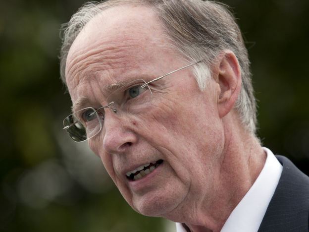 Gov. Robert Bentley talks with reporters outside the Capitol in Montgomery, Ala.,  on Wednesday. Bentley said he will work with the state attorney general to appeal the parts of the decision that struck down sections of the state's illegal immigrant law. (AP)