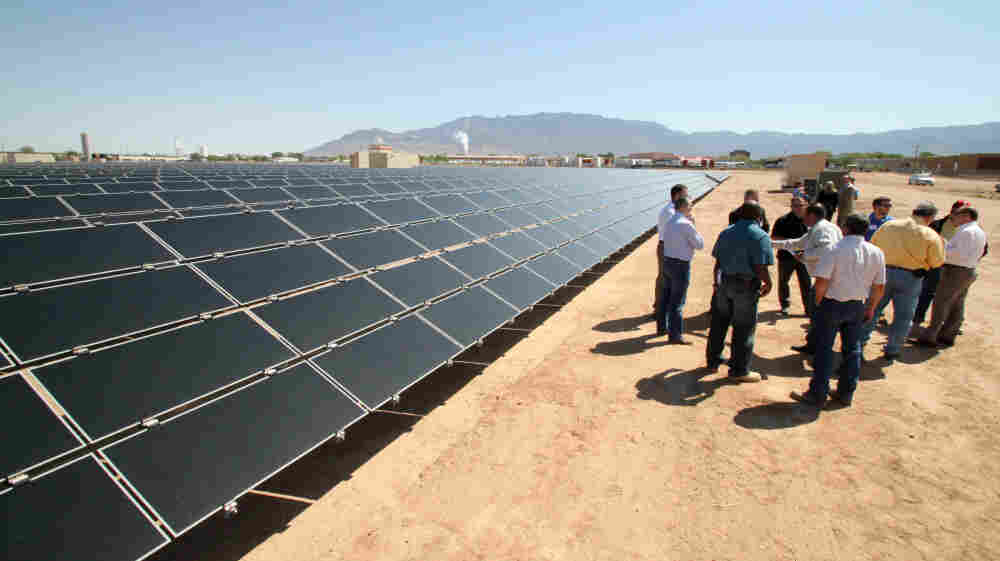 Officials from Arizona-based First Solar and a New Mexico power company gather after the dedication of a new solar array in Albuquerque in April.