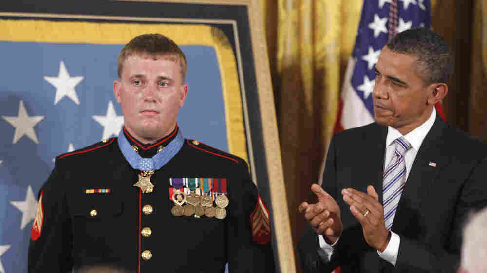 President Barack Obama applauds former Marine Cpl. Dakota Meyer, 23, on Thursday, Sept. 15, 2011, after awarding him the Medal of Honor at the White House.