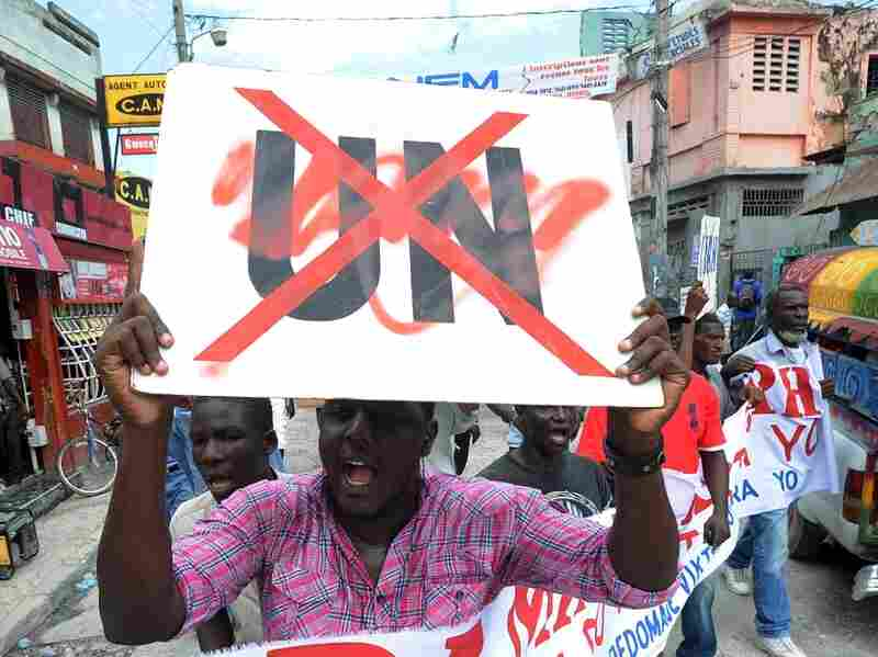 Haitians demonstrate on Sept. 23, 2011 in Port-au-Prince against the  UN mission in Haiti (MINUSTAH.) They protested against the alleged  sexual assault of an 18-year-old man in Port-Salut by Uruguayan  Peacekeepers. Haitians also blame UN Peacekeepers of a cholera outbreak  that began in 2010.