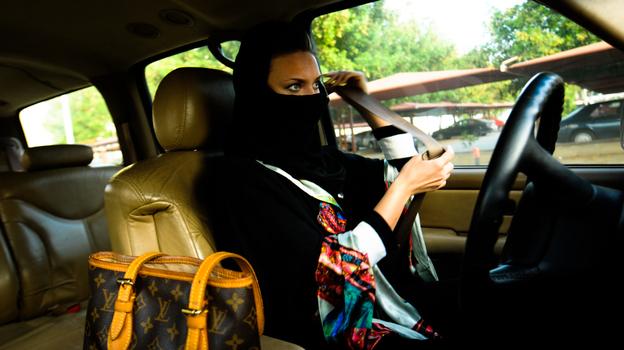 A Saudi woman fastens her seat belt before driving in Jeddah, western Saudi Arabia. (Michael Bou-Nacklie)