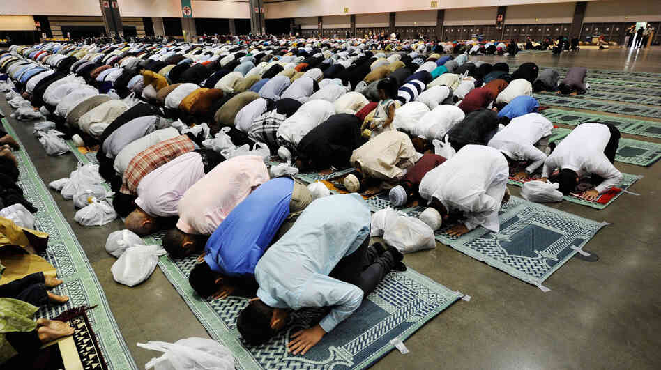 hide caption Muslims pray during the holiday of Eid ul Fitr at the Los