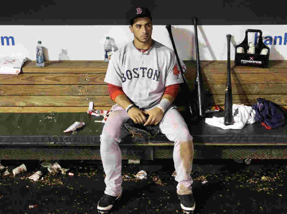 The agony: Boston Red Sox third baseman Mike Aviles sits in the dugout after his team's 4-3 loss to the Baltimore Orioles Wednesday (Sept. 28, 2011).