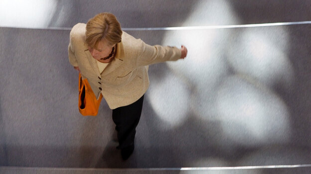 German Chancellor Angela Merkel leaves the Lower House of German parliament Bundestag in Berlin after a vote on legislation to expand the EU's rescue fund.