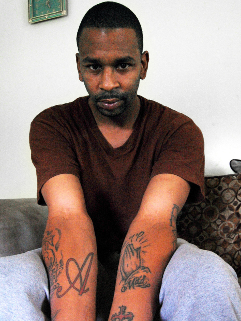 <p>Police allege Anthony Clemons is a member of the Bloods street gang. Clemons denies this by showing he has no gang tattoos.</p>