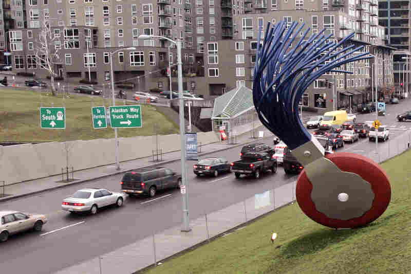 The 19-foot-tall Typewriter Eraser, Scale X, by Oldenburg and van Bruggen, stands in view of traffic passing Seattle's Olympic Sculpture Park.