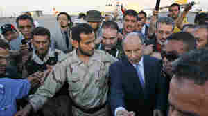 Abdel Hakim Belhaj (center left), a prominent militia commander, walks with Transitional National Council Chairman Mustafa Abdel Jalil in Tripoli on Sept. 10. The battle to oust Moammar Gadhafi produced a number of leaders who will have to work together to form a new government.