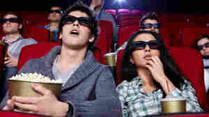 People watching a movie in 3D.