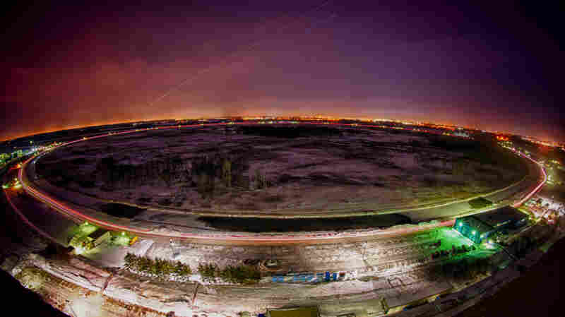 The main ring of the Tevatron, seen in a time exposure. For a quarter century, the particle accelerator at a lab outside Chicago was the most powerful machine of its kind in the world.