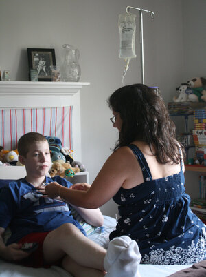 "Laura Zakhar connects her son, Kevin, 15, to the ""feedbag"" that contains his nutrition. Lately, Zakhar has had trouble getting the calcium solution Kevin needs, in part because  hospitals have been reserving limited supplies for patients who need it even more desperately  than he does."