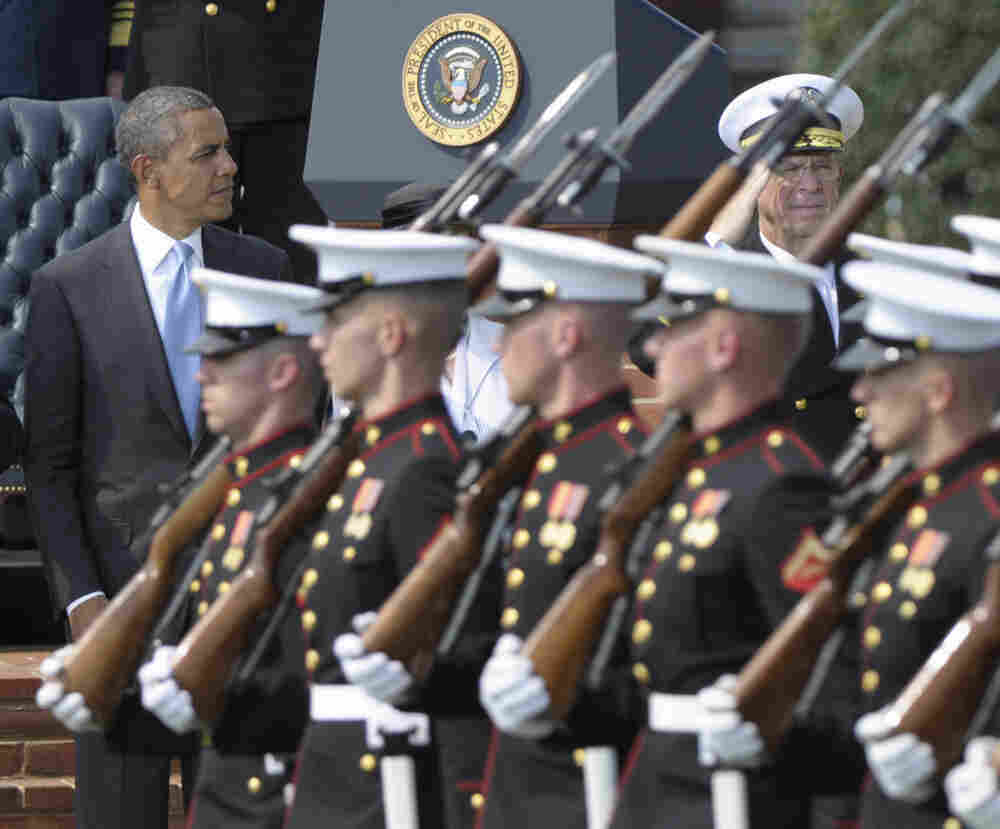 President Obama at the retirement ceremony for Joint Chiefs Chairman Adm. Mike Mullen (r) Sept. 30, 2011.