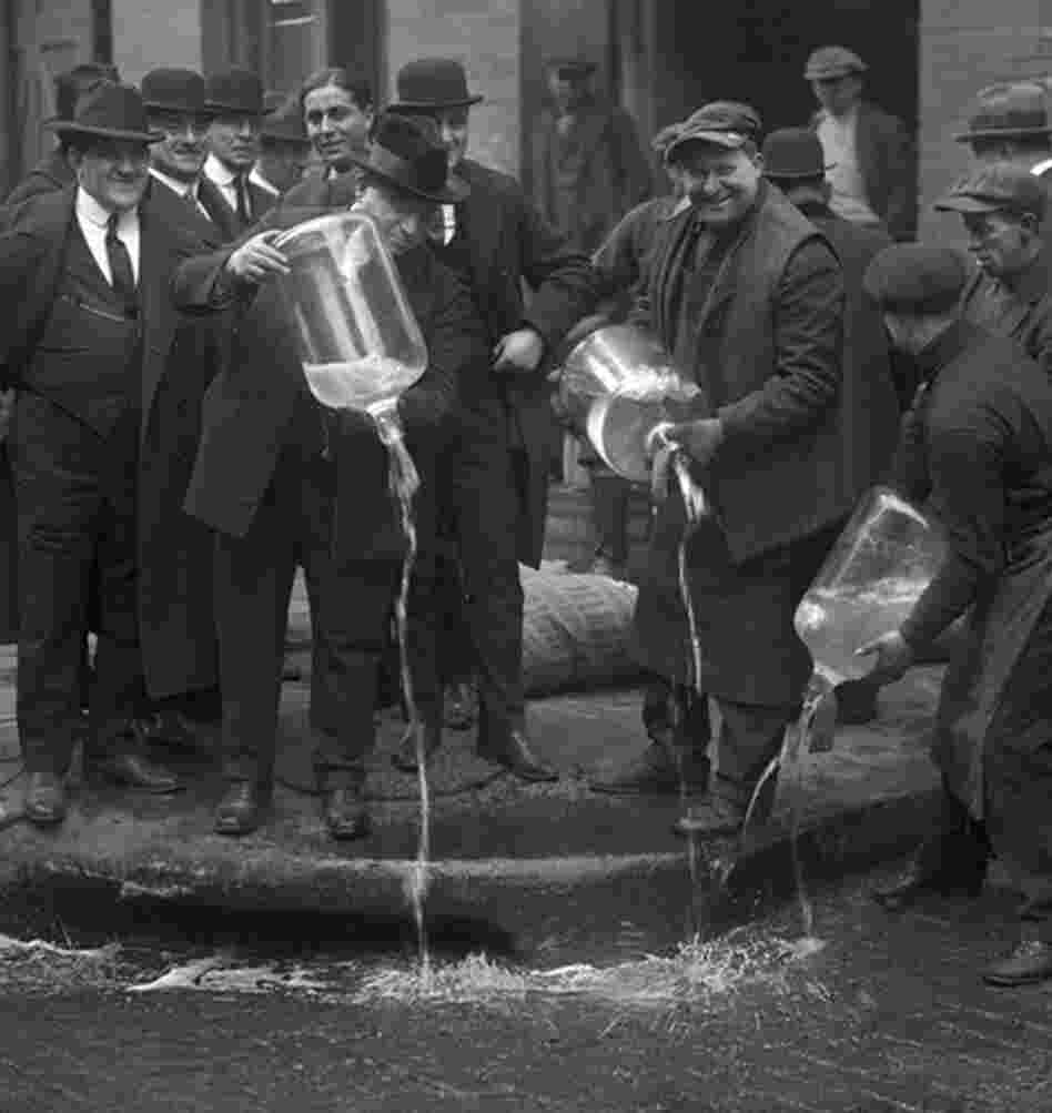 Agents pour out alcohol into the gutter during a raid. Ken Burns' Prohibition airs beginning Sunday night on PBS.