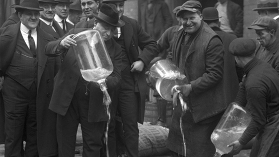 Agents pour out alcohol into the gutter during a raid. Ken Burns' Prohibition airs beginning Sunday night on PBS. (New York Daily News)
