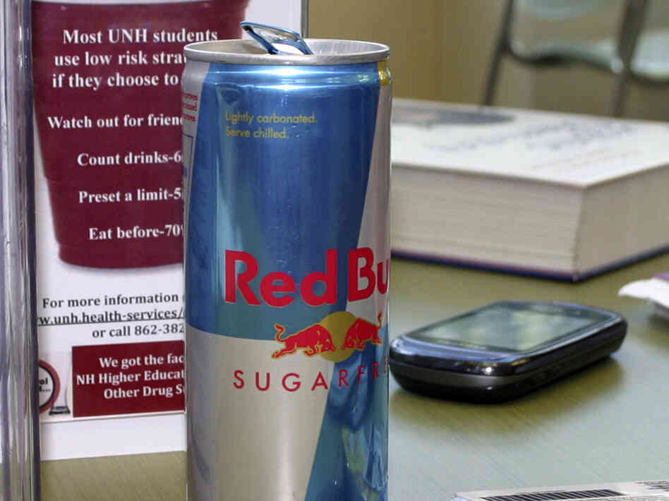 A can of Red Bull, cracked and ready for consumption, on a table at the student union building at the University