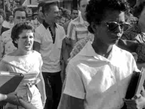 Elizabeth Eckford (right) attempts to enter Little Rock High School on Sept. 4, 1957, while Hazel Bryan (left) and other segregationists protest. The book Elizabeth and Hazel chronicles not just that event but the months and years that came after in the two women's lives.