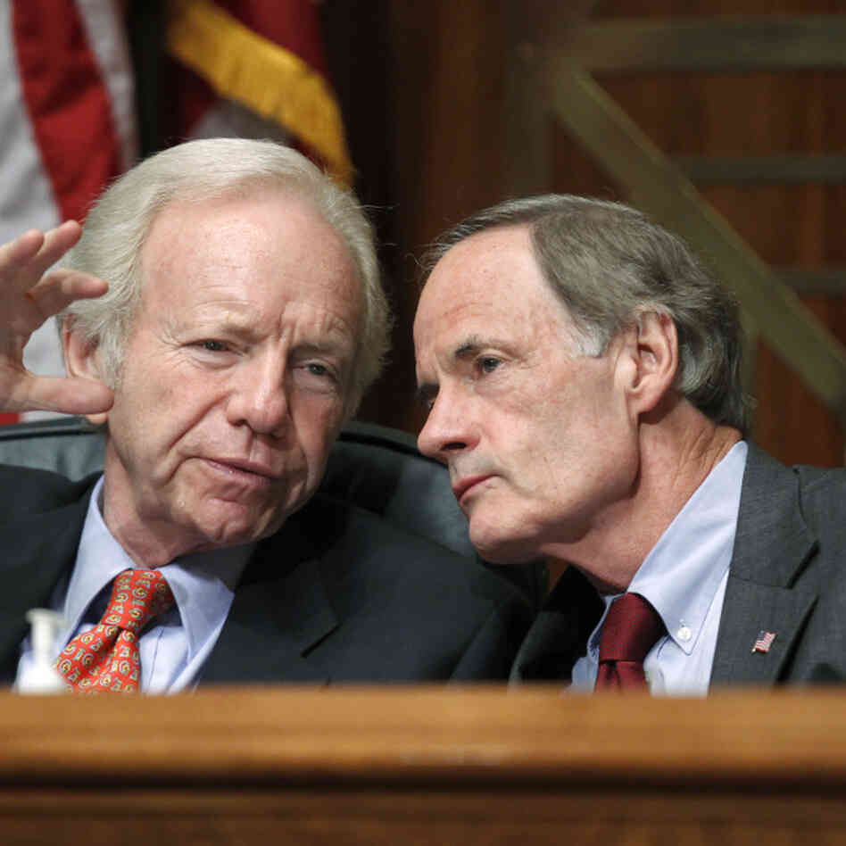 During a hearing on the troubles of the U.S. Postal Service, Sen. Joseph I. Lieberman (I-CT), left, confers with Sen. Tom Carper (D-DE), who chairs the Senate subcommittee that oversees the Postal Service.