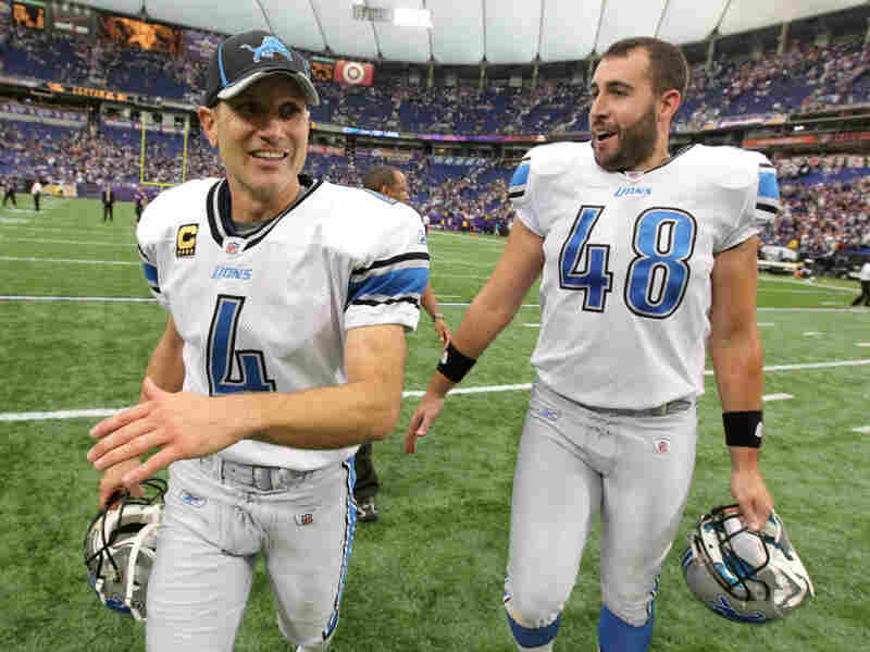 Detroit Lions Jason Hanson (left) and Don Muhlbach walk off the field after Hanson kicked a 32-yard field goal in overtime to beat the Minnesota Vikings last Sunday in Minneapolis. The Lions won 26-23.