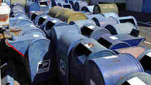 U.S. Postal Service mailboxes are seen awaiting disposal in San Jose, Calif. Because of steeply declining use, the U.S. Postal Service has removed more than 60 percent of the blue boxes.