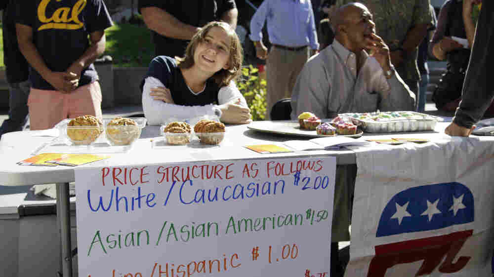 """A student who identified herself as """"Hannah"""" works at a bake sale led by the Berkeley College Republicans on Sept. 27 at the University of California campus in Berkeley, Calif."""