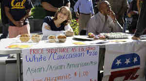 "A student who identified herself as ""Hannah"" works at a bake sale led by the Berkeley College Republicans on Sept. 27 at the University of California campus in Berkeley, Calif."