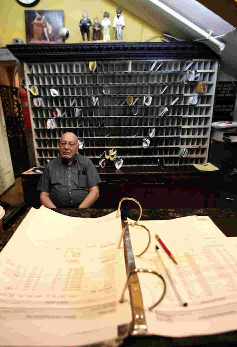 "Front desk manager Jerry Weinstein is shown on duty in June 2007. Since then, most of the Chelsea staff have been let go. ""It was like we didn't have family anymore,"" says long-term resident Nicola L."