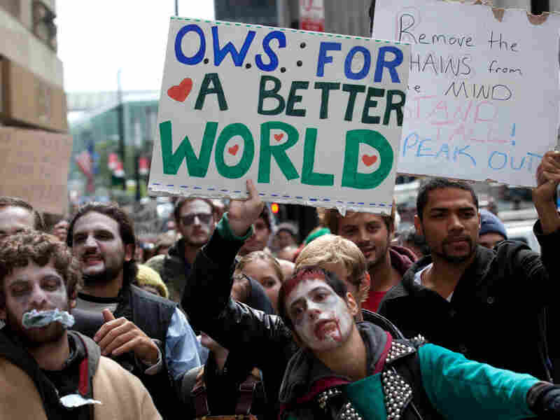 Protesters march through New York's financial district dressed as corporate zombies on Monday.