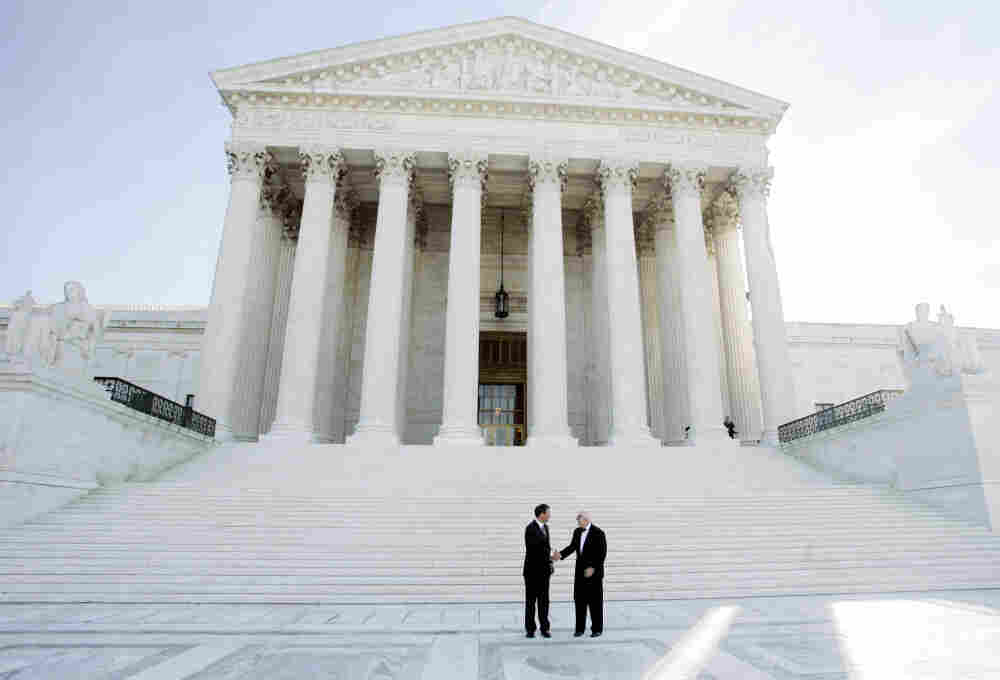 Justice John Paul Stevens (right) stands with newly sworn-in Chief Justice John Roberts in front of the U.S. Supreme Court in October 2005. Stevens' new book, Five Chiefs, is a discussion about the office of chief justice, featuring detailed profiles of the five Stevens knew well: Fred Vinson, Earl Warren, Warren Burger, William Rehnquist and John Roberts.