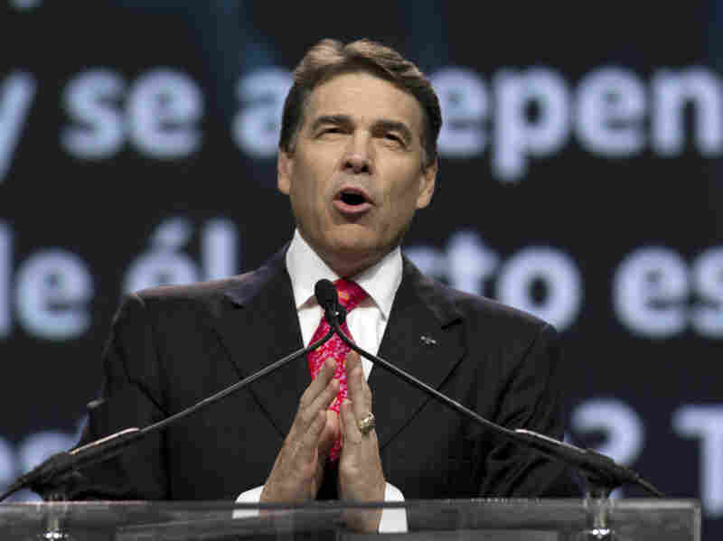Texas Gov. Rick Perry prays at The Response, his call to prayer for a nation in crisis, on Aug. 6 in Houston. The event was organized, in part, by members of the New Apostolic Reformation.