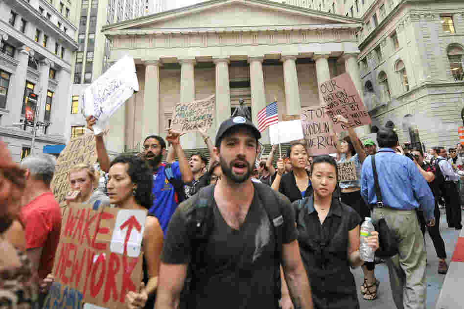 The Occupy Wall Street protest began more than two weeks ago. On Sept. 26, protesters marched past Federal Hall on Wall Street.