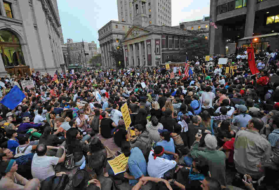 Protesters in New York sit in the plaza of police headquarters on Sept. 30.