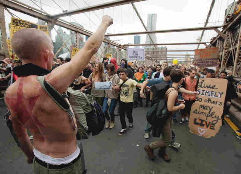 A large group of Occupy Wall Street protesters demonstrating against corporate greed and social inequality, among other grievances, attempt to cross the Brooklyn Bridge in New York on Oct. 1, effectively shutting down parts of the bridge.