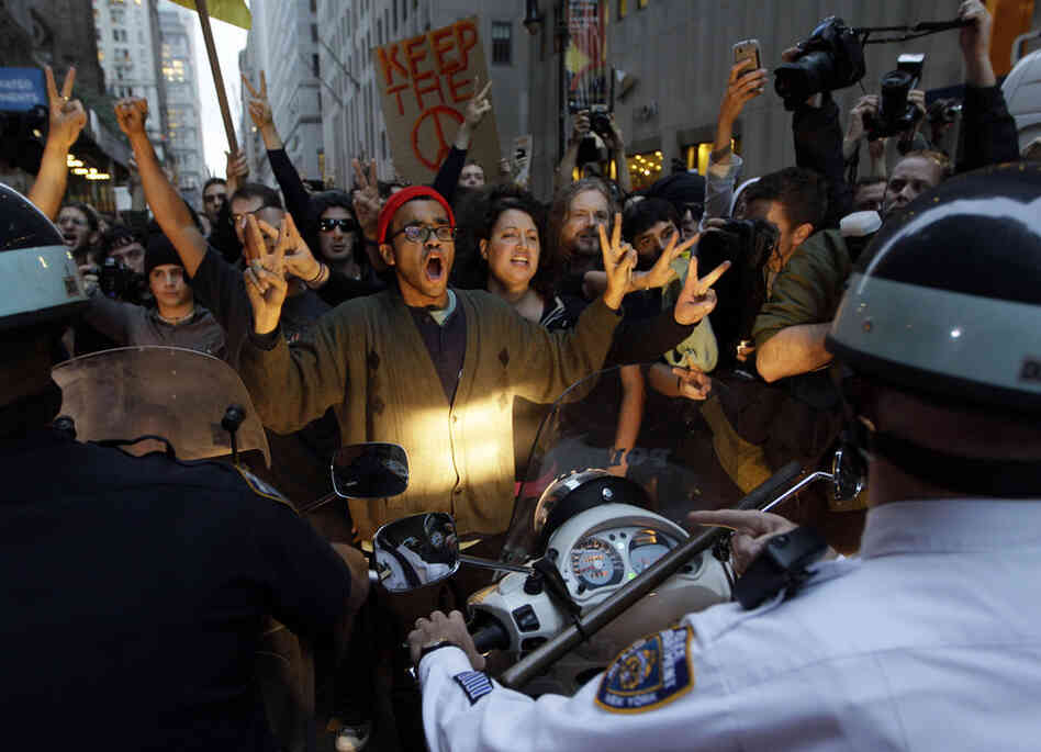 Occupy Wall Street protesters confront New York City police officers Friday.