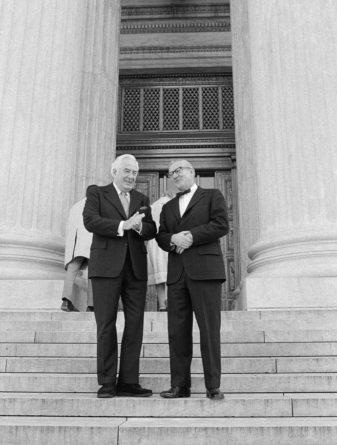 December 1975: Chief Justice Warren Burger (left) talks with Stevens on the steps of the Supreme Court before Stevens' swearing in as the 101st justice.