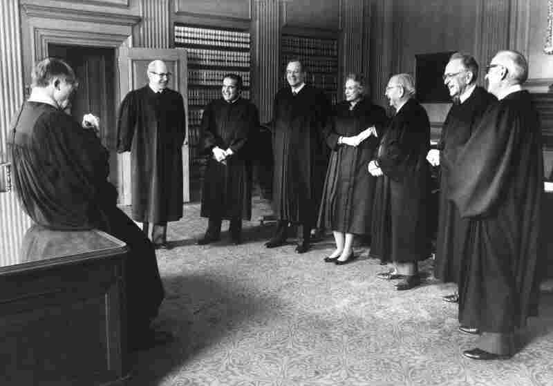 February 1988: Chief Justice William Rehnquist (left) gathers with the court before the investiture of Anthony Kennedy. From left: Rehnquist, Byron White, Antonin Scalia, Kennedy, Sandra Day O'Connor, William Brennan, Harry Blackmun and John Paul Stevens.