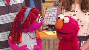 Lily and Elmo on the Sesame Street Growing Hope Against Hunger special.