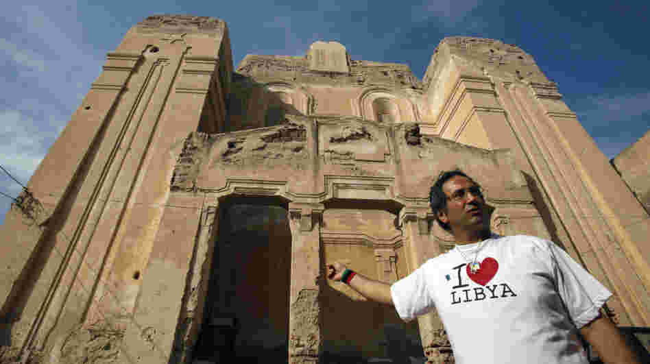David Gerbi stands in front of the main synagogue in Tripoli, Libya, on Sunday. An exiled Libyan Jew, he has returned after being away for more than 40 years. He hopes to restore the synagogue and create an atmosphere of tolerance in the aftermath of Gadhafi's ouster.
