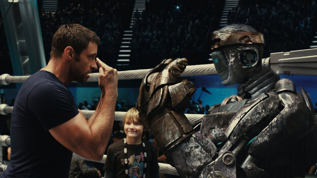 Fists Of Steel: Robot-boxing trainer Charlie Kenton (Hugh Jackman) makes an underdog discovery in Atom, an outdated robot with surprising potential.