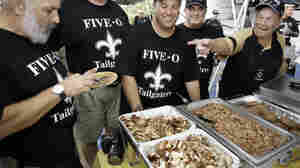 Tailgaters enjoy the food before a Tennessee Titans-New Orleans Saints football game in 2007.