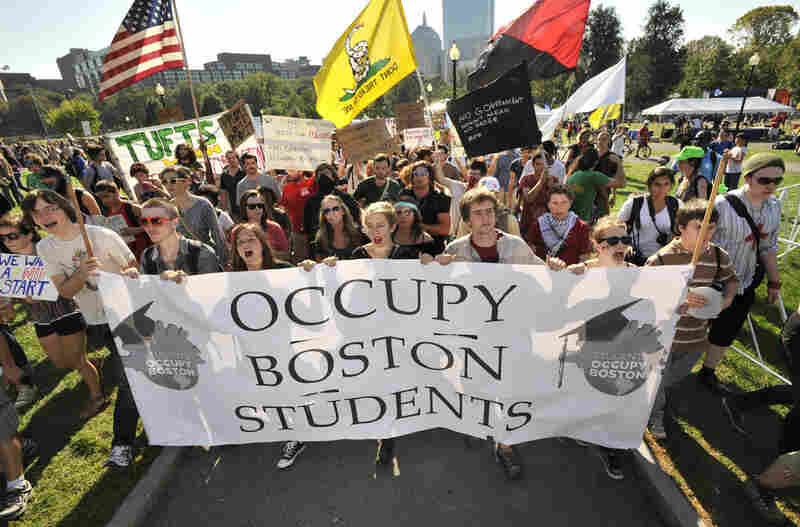 Demonstrators with Occupy Boston march through Boston Common on Monday afternoon.